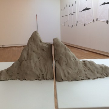 Gallery view performance drawings of the islands in the fjord outside the building using head optic. Clay mountain.